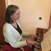 Janet playing her harpsichord